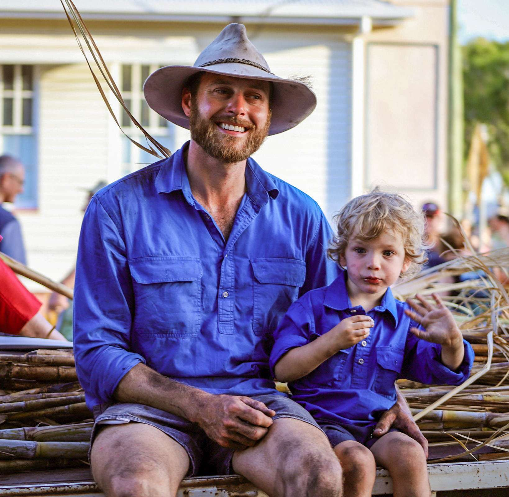 dave and ryder nephew dressed as cane cutters home hill harvest fest parade 2019 1